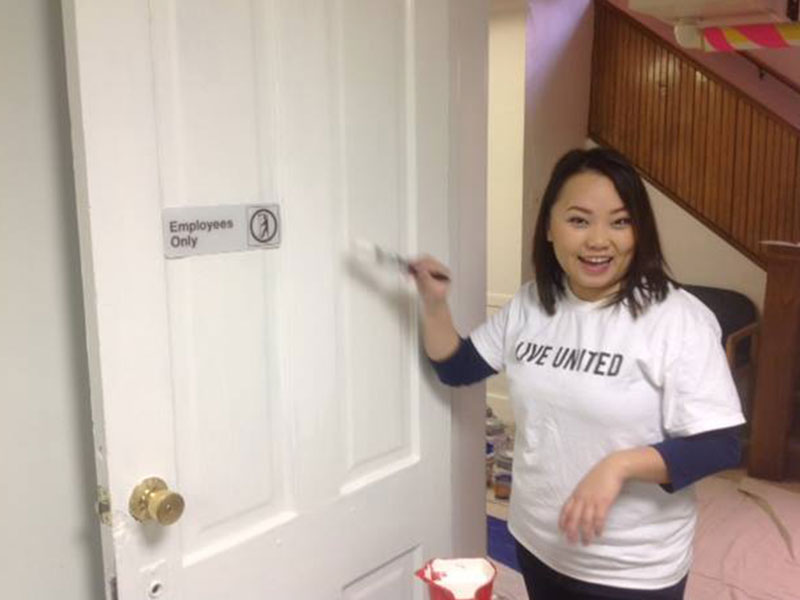 Volunteer Painting Door